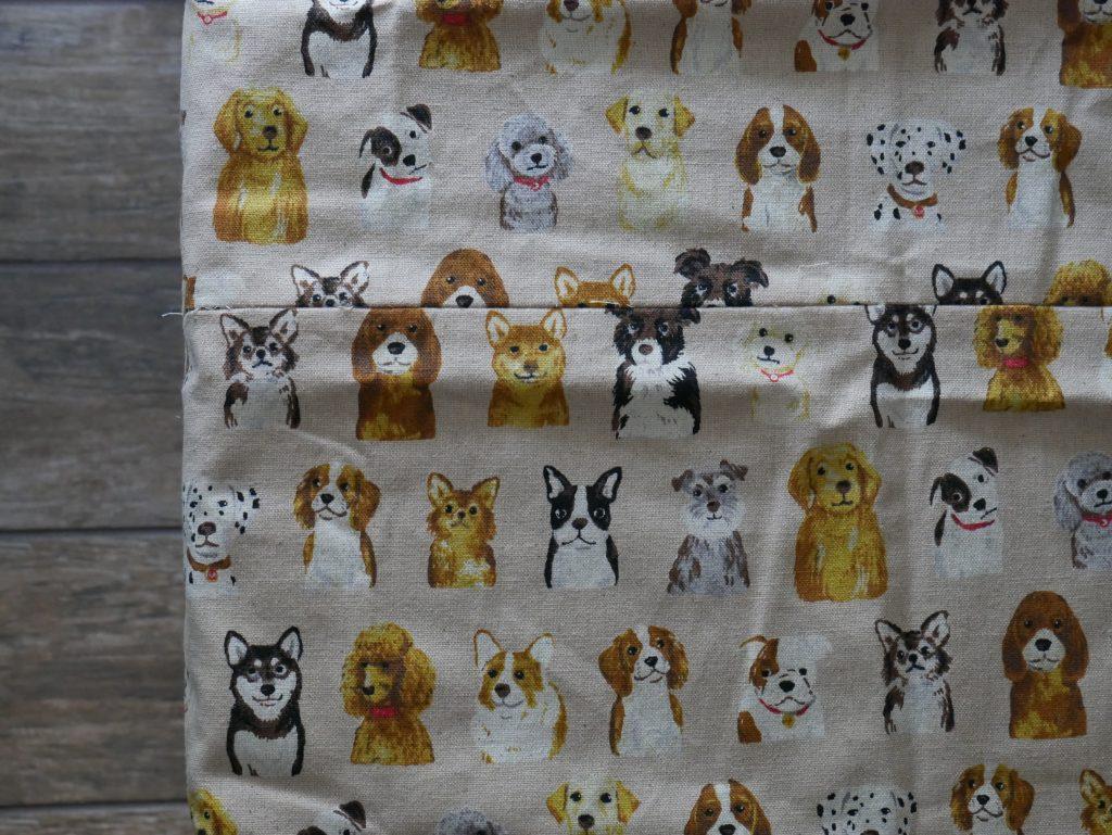 a handmade tablecloth with kokka dog breed fabric.
